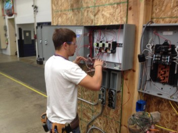 student wiring an electrical panel