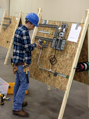 student wiring a project