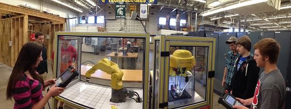 students programming robot arm