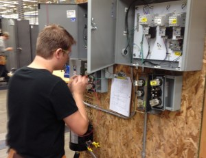 student wiring electrical control panel