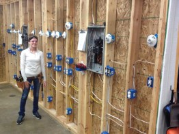 student posing with wiring project