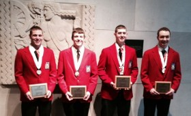 4 students posing with state awards