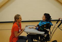 medical student working with student in wheelchair