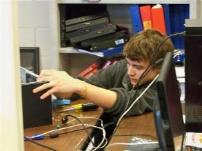 Student troubleshooting a computer