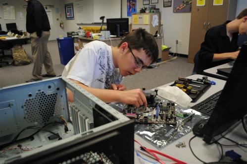 student assembling a computer