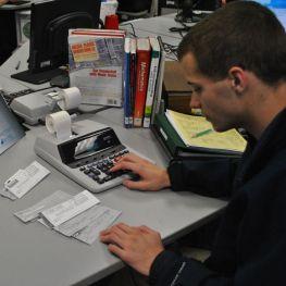 student working adding machine