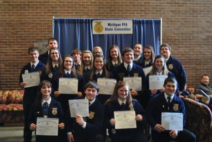 many students posing with certificates