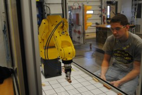 student testing his programing of robot