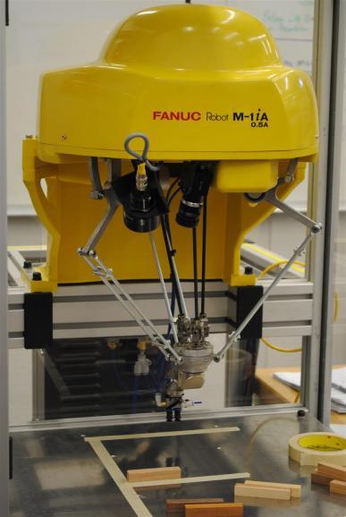 Robot spider over random Jenga parts