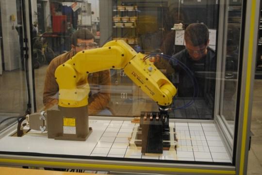 robot gripping a battery