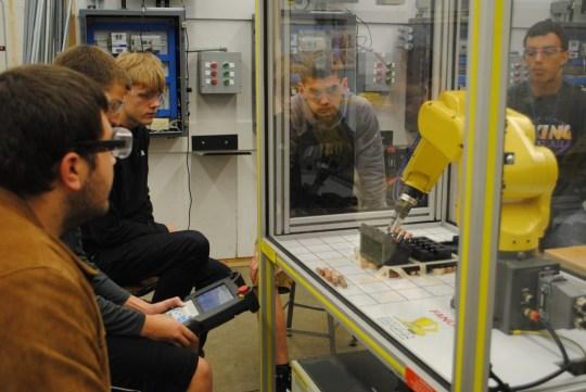 students programming a robot