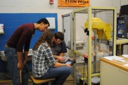 students checking the robots programming