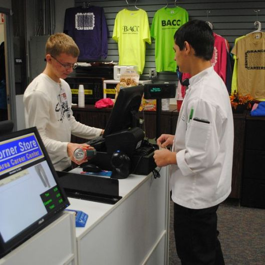 2 students working at cash register