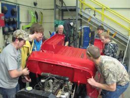 student assembling a jeep