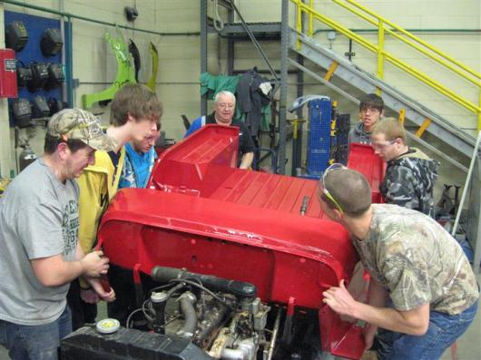 student assembling a jeep
