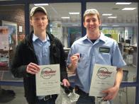 2 students holding wwards