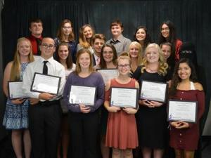BACC NTHS Inductees holding awards.