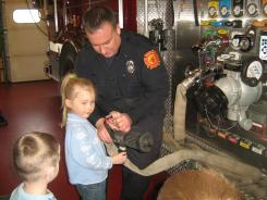 Fireman with student