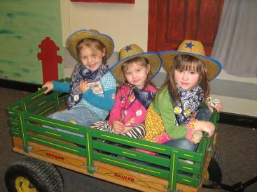 3 girls in green wagon