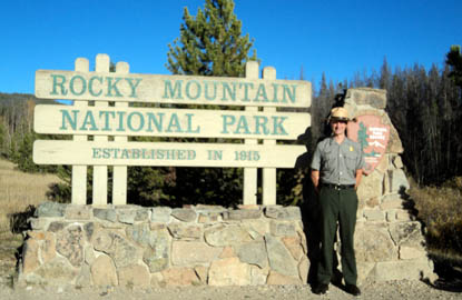 Rocky Mountain National Park sign with ranger
