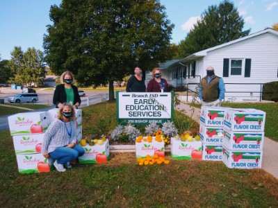 Staff with pumpkin donations