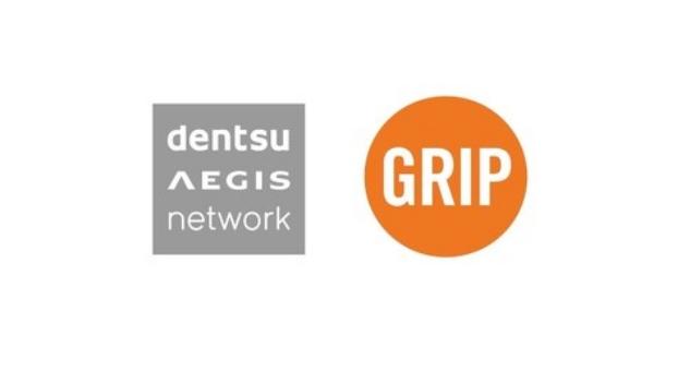 Dentsu Grip Logo