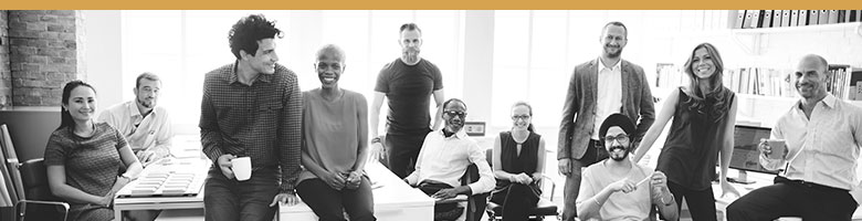 Black and white image of a brand stakeholders, employees. An office full of diverse employees.
