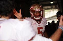 Jameis Winston high fiving Cason Beatty