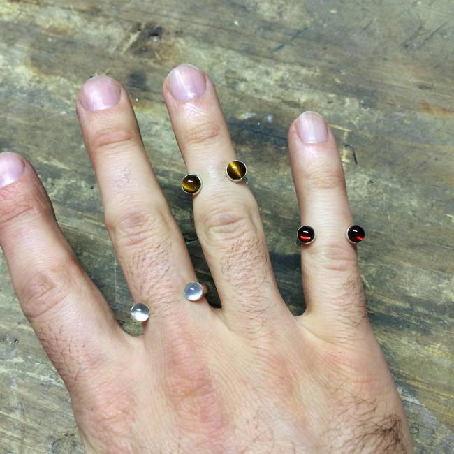 open_top_rings_sterling_silver_garnet_moonstone_tiger_eye_on_man_hand_model