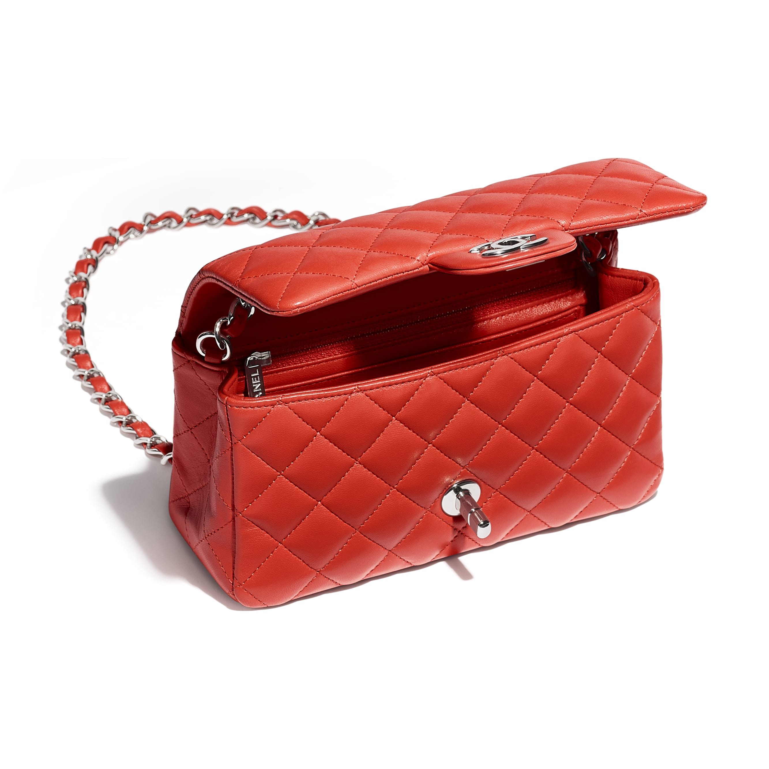 23496cd710a2 Small Flap Bag With Top Handle $5,600. Material : Lambskin & Gold-Tone Metal  Dimensions : 6.6 x 9.8 x 4.7 in ( cm )