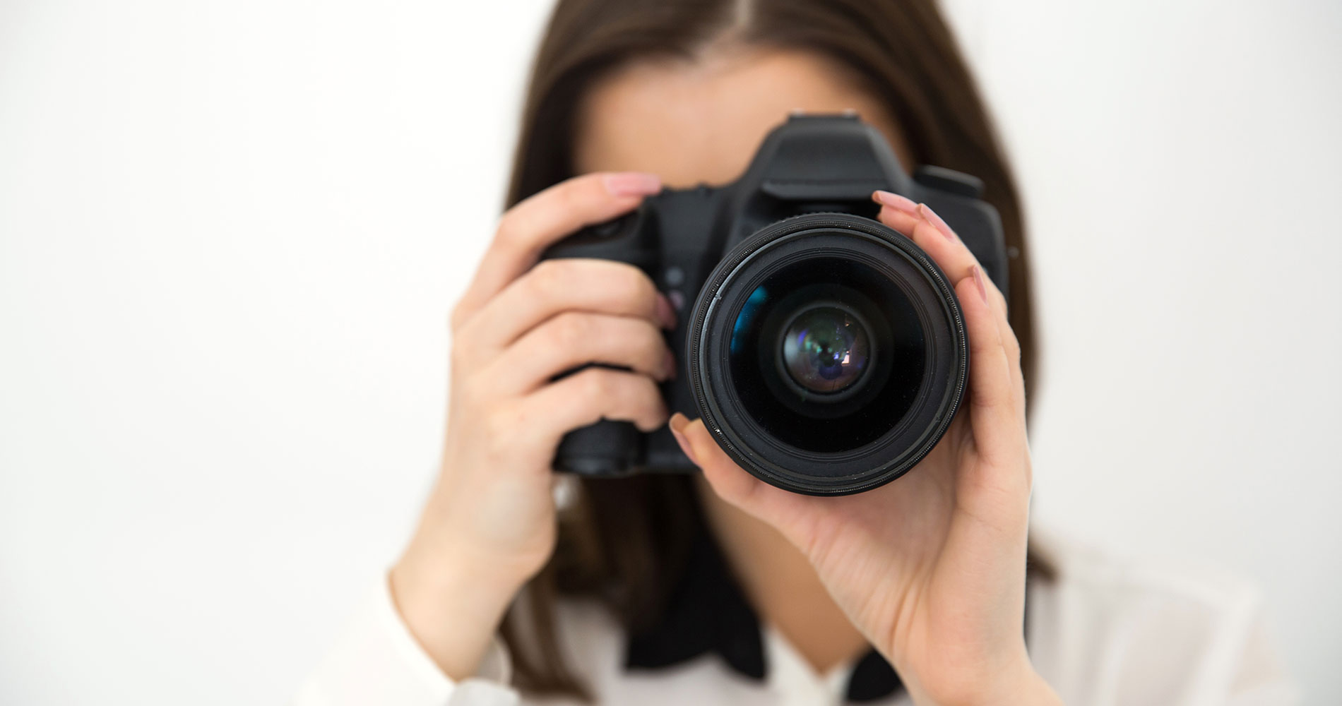 Female photographer looking into camera