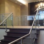 Staircase Showcasing Glass Guardrails, Glass Clips & Stainless Steel Handrails