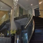 Curved Glass and Stainless Steel Staircase