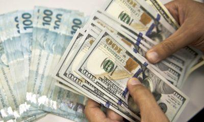 Dólar ignora euforia na Bolsa e sobe a R$ 5,10 com demanda no balcão e fiscal