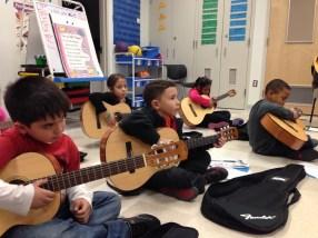 children playing guitars