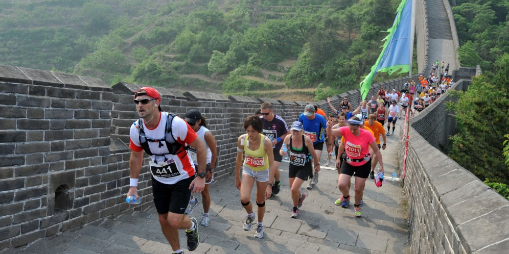 Runners compete in the Great Wall marathon at Huangyaguan (Yellow Cliff Pass) Great Wall of China in Tianjin on May 19, 2012. The annual race attracts more than 1,600 athletes from 49 countries and is regarded as one of the most challenging marathons in the world. CHINA OUT AFP PHOTO (Photo credit should read STR/AFP/GettyImages)