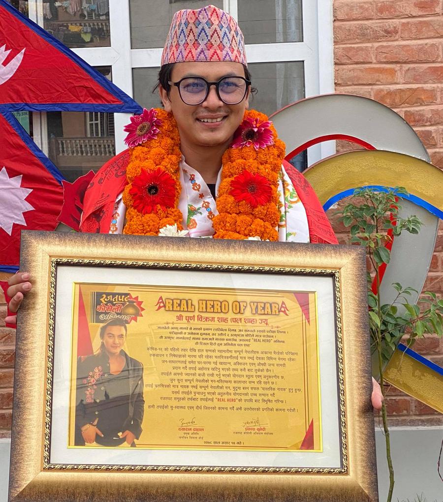 Paul Saha with Real Hero Title