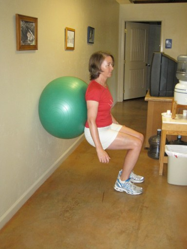wall squats with an exercise ball