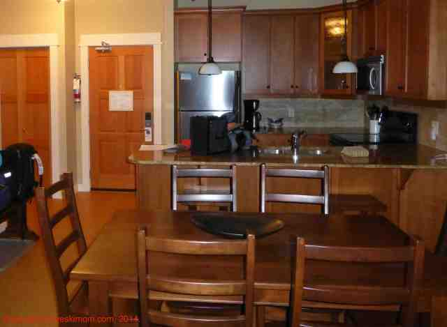 a dining room and condo kitchen at silver star mountain resort bc