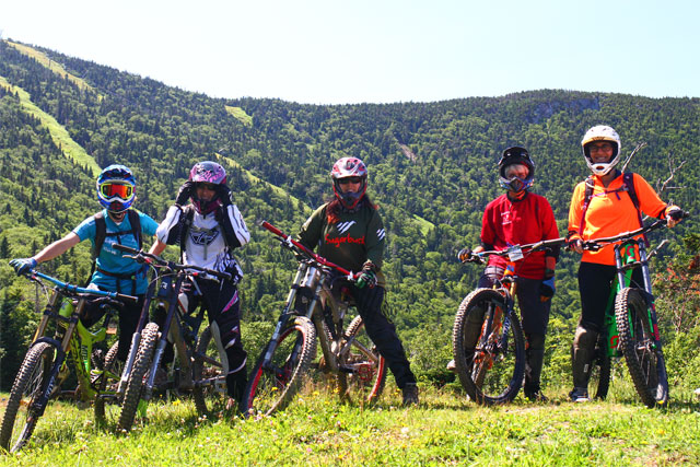five downhill bike riders pose for a photo at Sugarbush Vermont.