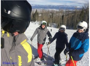 family skiing together at powderhorn mountain colorado