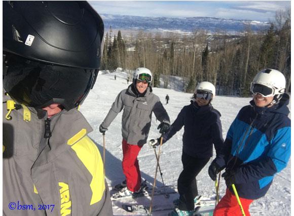 family skiing together at powderhorn mountain colorado