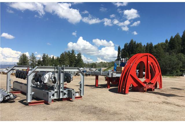 chairlift bull wheel and terminal parts awaiting installation at snow basin utah