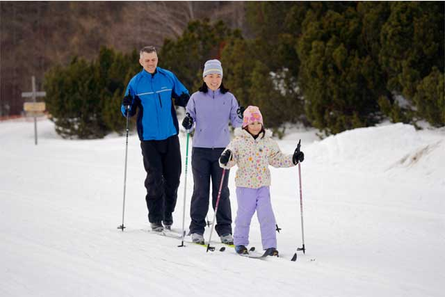 Family skiing the Trapp Family Lodge near Stowe VT