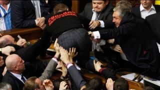 Ukraine's new parliament opens with a brawl