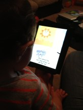 "Braxton ""reading"" a story on the iPad"