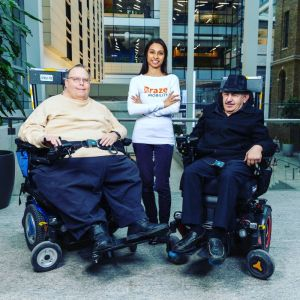 Photo of founder with wheelchair users