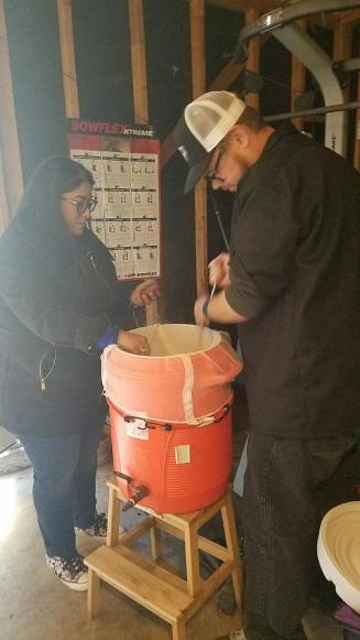 Clarissa checking the mash temp