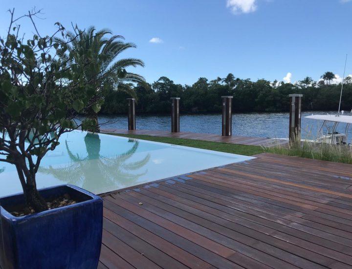 Ipe hardwood pool deck with matching ipe dock overlooking the intercostal