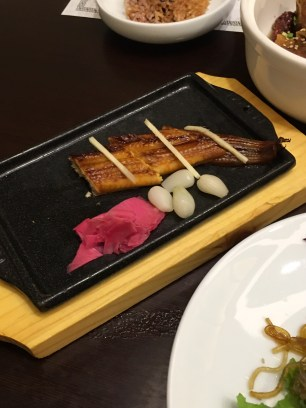 Grilled eel with ginger, pickled garlic